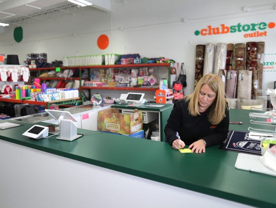Cindy Schooley works at her and her husband's store