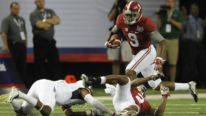 Mickey Welsh/Advertiser Wide receiver Amari Cooper enjoyed a big day Saturday, hauling in 12 receptions for 130 yards. Alabama wide receiver Amari Cooper (9) finds running room against West Virginia in the Chick-fil-A Kickoff Game at the Georgia Dome in Atlanta, Ga. on Saturday August 30, 2014.