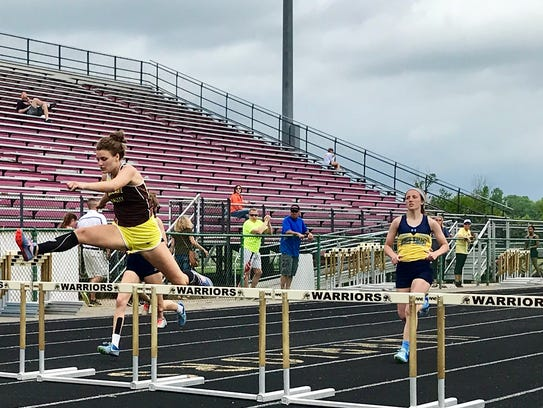 Nina Hilt of Buckeye Valley, left, won the girls 300