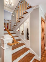 New staircases are code-compliant and easier to climb, and are now design feature elements, with custom-designed wood railings.