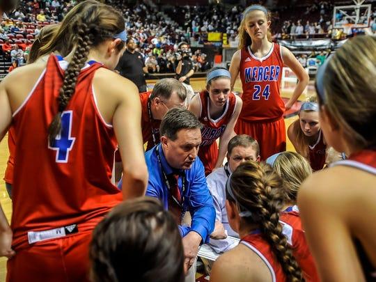 Mercer County's head coach Chris Souder, center, talks
