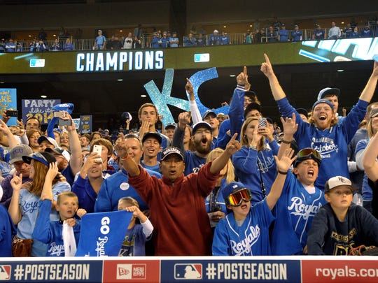 Kansas City Royals fans celebrate in the stands after