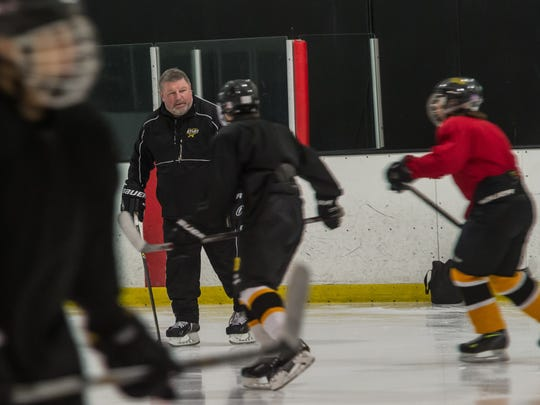 South Brunswick High School ice hockey coach Sergei Starikov conducts practice on Friday, Nov. 20.