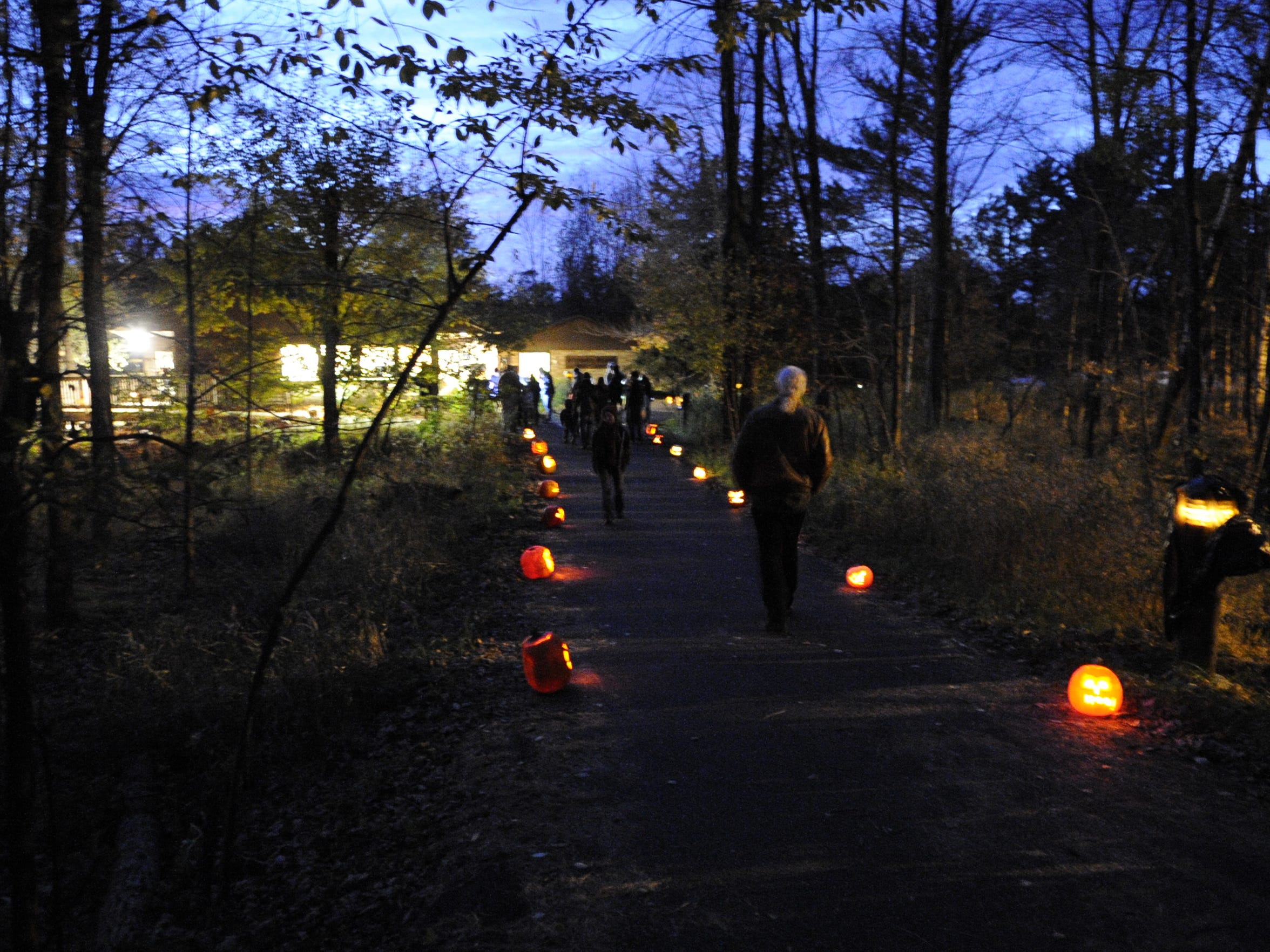 Hundreds of people gather at the University of Wisconsin-Stevens Point Schmeeckle Reserve for a candlelight hike in fall 2013.