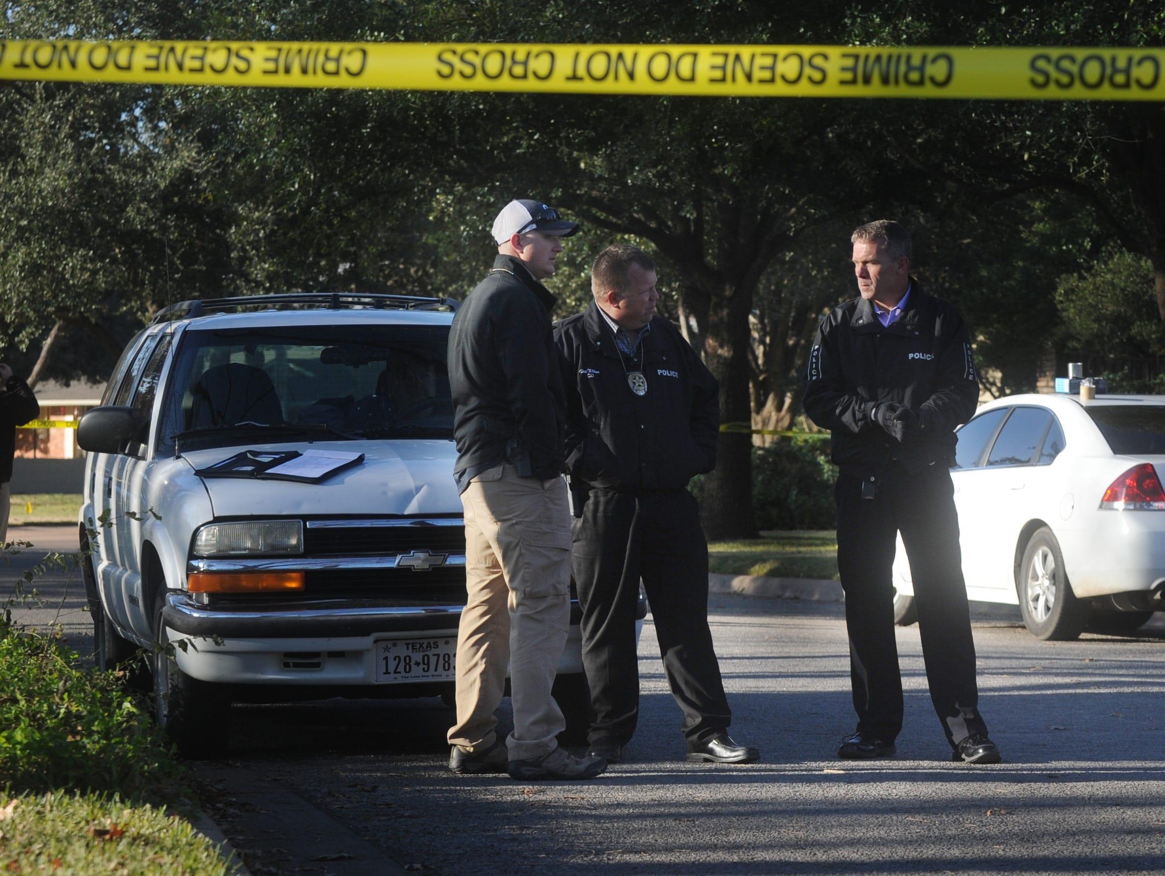 Abilene Police Chief Stan Standridge, right, detectives