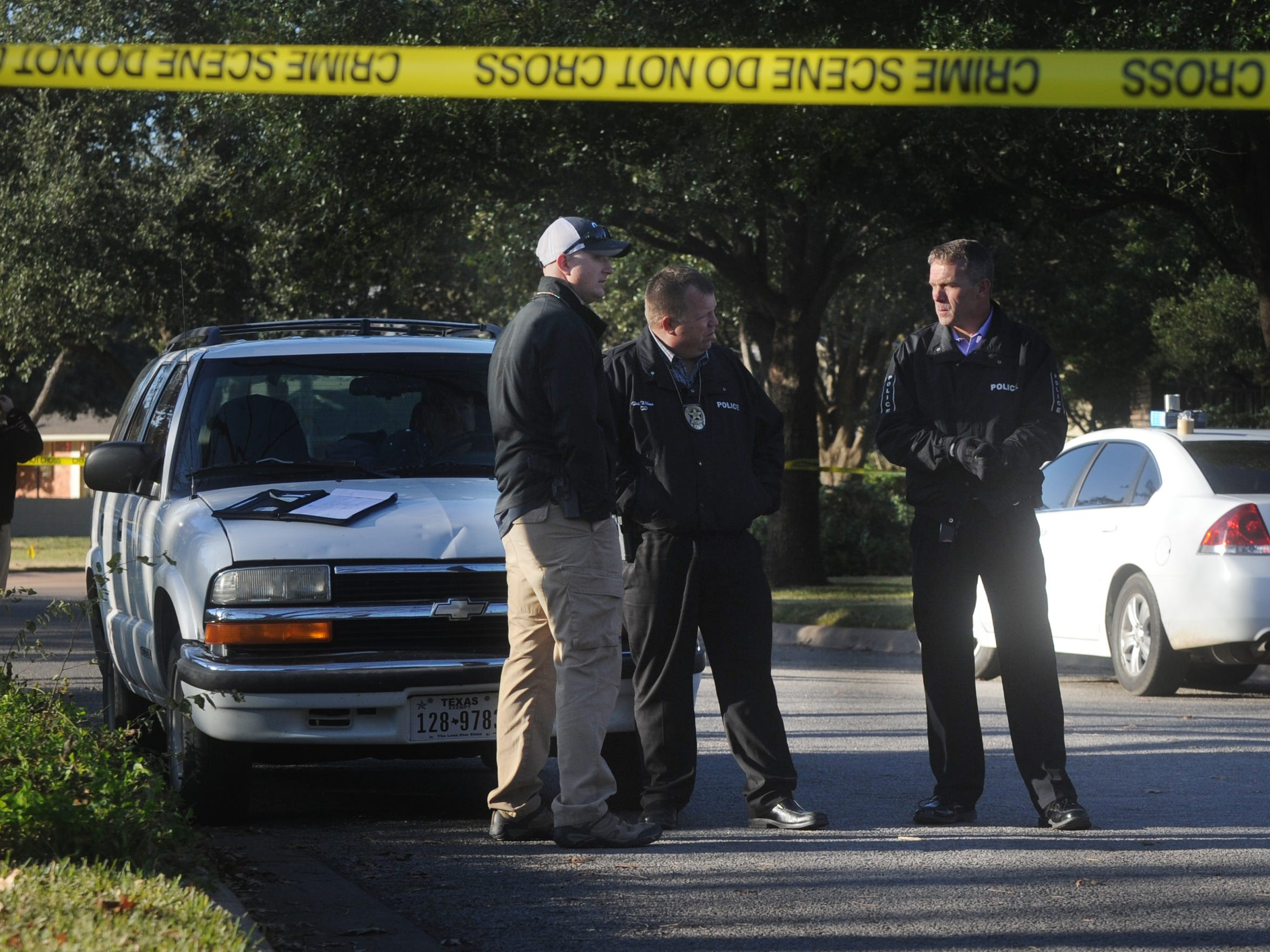 Abilene Police Chief Stan Standridge, right, detectives and forensic unit members work the scene of a fatal shooting in the 3700 block of Woodridge Drive on Monday, Dec. 12, 2016. Realtor Thomas Niblo was shot multiple times inside his residence.