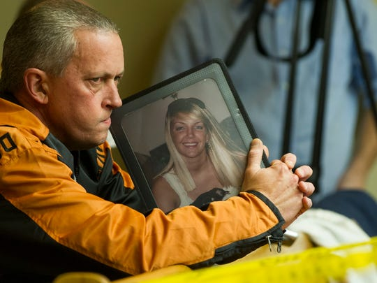 Gary Christian holds a photograph of his murdered daughter,