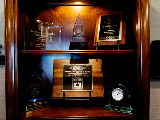 Awards and recognitions sit on a shelf in Mike Connor's office at Connor Concepts offices at 10911 Turkey Drive in Knoxville, Tennessee on Thursday, February 23, 2017. Connor Concepts is celebrating its 25th year in business.
