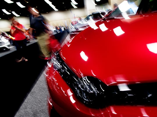 Visitors walk down the aisle at the annual Knoxville News Sentinel Auto Show at the Knoxville Convention Center on Feb. 25, 2017.