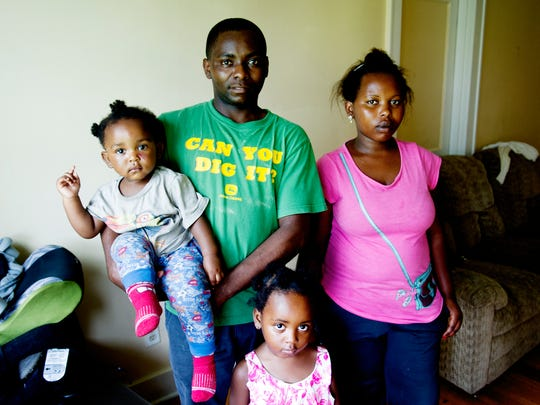 Joseph Mpawenimana poses with his wife, Tantine Scovia, and daughters Safi Maombi, 1, and Anna Rebecca, 3, at their apartment on East Magnolia Avenue in Knoxville on Thursday, June 15, 2017.