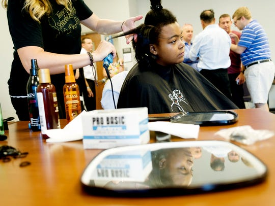 Messiah Underwood, 12, gets her hair done by Chrissie