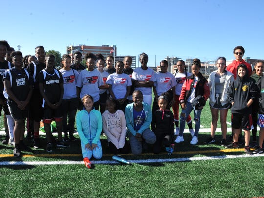 Track athletes from Neptune, Long Branch, Asbury Park and Holmdel high schools participated in a brief meet in honor of Olympian Ajee' Wilson.