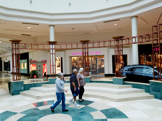 Visitors walk through the amphitheater at West Town Mall in West Knoxville.