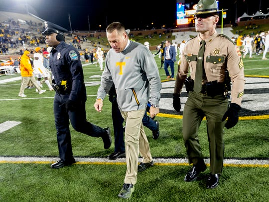 Tennessee Head Coach Butch Jones walks off the field after the loss during a game between Tennessee and Missouri at Faurot Field in Columbia, Missouri, on Saturday November 11, 2017.