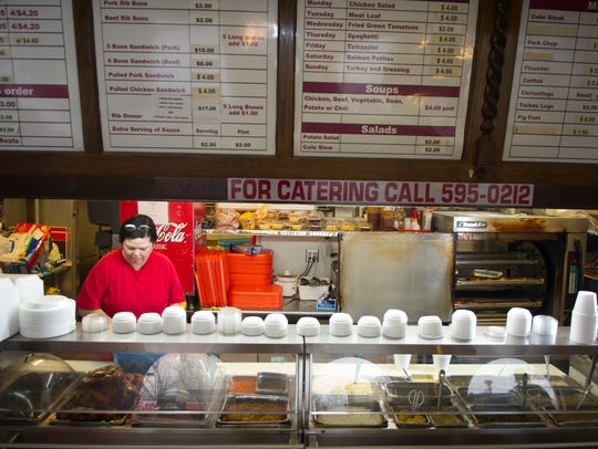 Gwen Chandler of Chandler's Deli, 3101 Magnolia Ave.,  prepares the steam table for the lunch rush in this 2014 file photo.