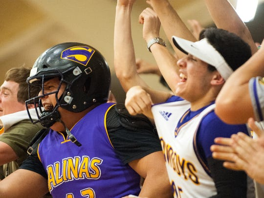 Salinas fans packed the visiting student section for the game and cheer as senior forward Isaiah Orozco hits a three-pointer in the first quarter.