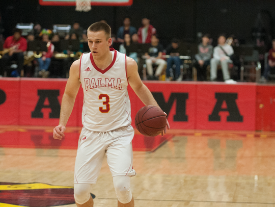 Palma senior forward Garrett Maker slows down his dribble