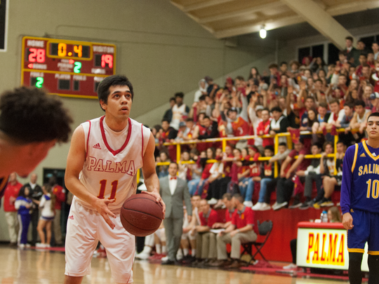 Senior guard Joey Burlison (11) lines up for a free throw that would give Palma a 29-19 lead going in to halftime.