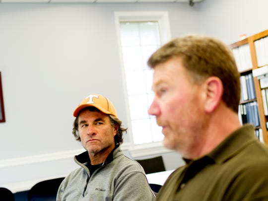 Mack Schmidt listens as Brian Niekerk talks about their company, Lake Weed Controls, in Kingston, Tennessee on Wednesday, March 7, 2018. Brian Niekerk and Mack Schmidt launched their company Lake Weed Controls to combat invasive aquatic plants like hydrilla in residential and commercial waterfront properties.