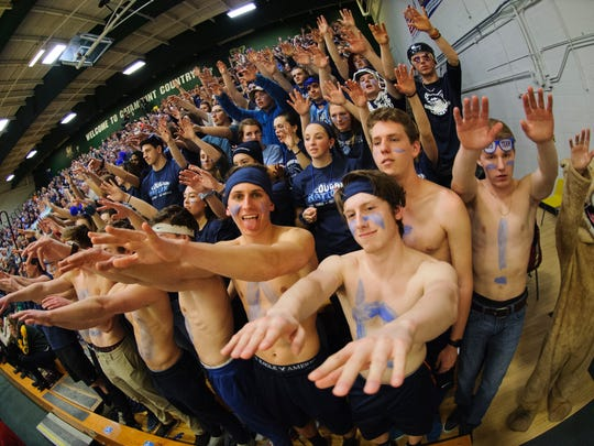 MMU fans cheer for the team during the Vermont state