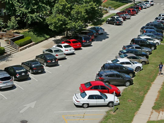 Every available parking spot is filled on Waldron Street between Third and Fourth streets Thursday, August 20, 2015, near the campus of Purdue University. West Lafayette Police Department is using a new systems to enforce parking in high density area near the Purdue University campus.