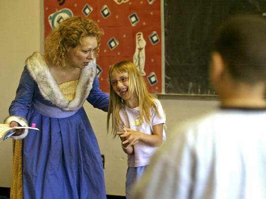 """Actress Alissa Tschetter-Siedschlaw of Des Moines helped Susan Stacy of Des Moines deliver a few lines from """"Romeo and Juliet"""" during a Metro Arts Alliance program in 2004 at the East Side Library in Des Moines."""