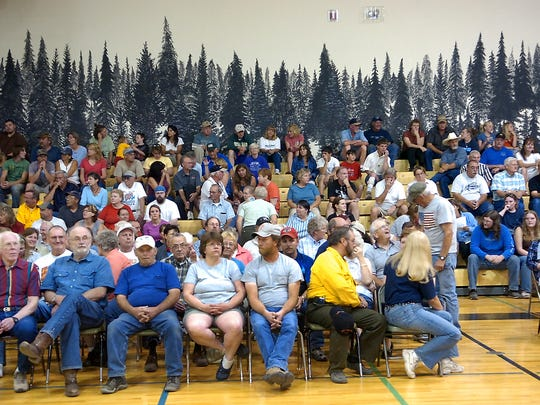 Residents gather for a fire information meeting in