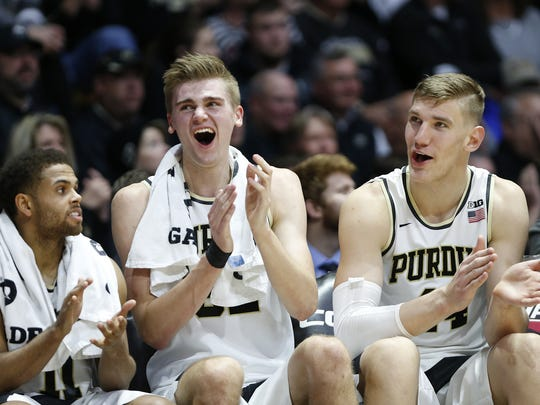P.J. Thompson, from left, Matt Haarms and Isaac Haas