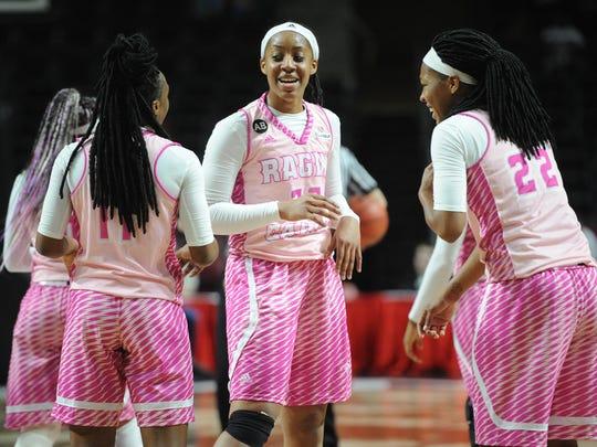 Coach Broadhead and his team honoring breast cancer