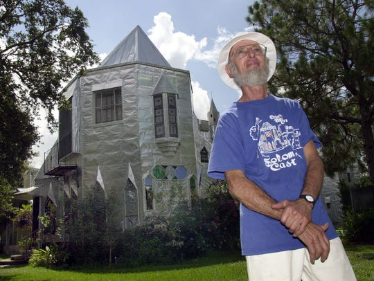 Howard Solomon poses outside his castle June 17, 2003,