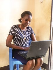 Laptop recipient Ester Lukas, a student at Tanzania's
