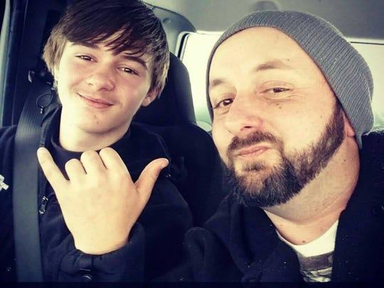 Chad Weaver with his son Dakota, 15.