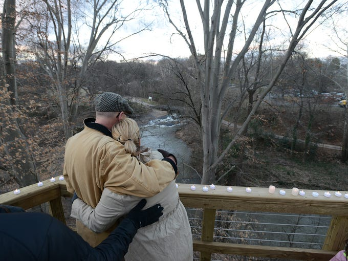 Tom Bates, left, stands with his wife Ashley, during