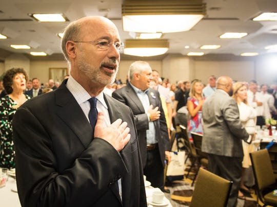 Gov. Tom Wolf recites the pledge of allegiance before the start of the Pennsylvania Delegation breakfast at the DoubleTree by Hilton in Philadelphia on Monday, July 25, 2016.