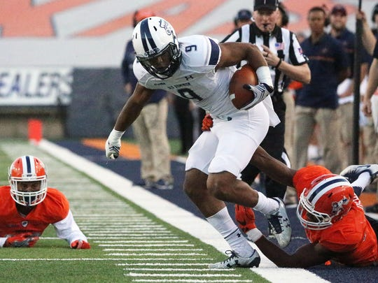 Old Dominion wide receiver Jonathan Duhart, 9, is pulled out of bounds by UTEP's Nick Usher, 36, after racking up yardage on the play Saturday in the Sun Bowl in El Paso, TX.