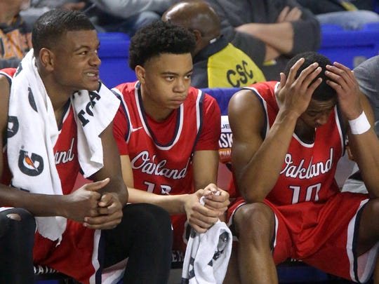 Oakland'sTre Jones (1), Ray Tyler (12) and Michael Hayworth (10) react to trailing Southwindduring the final mintues of the quarterfinal round of the Class AAA State Tournament on Wednesday, March 15, 2017.