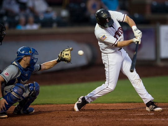 Evansville's Travis Harrison (17) swings and misses