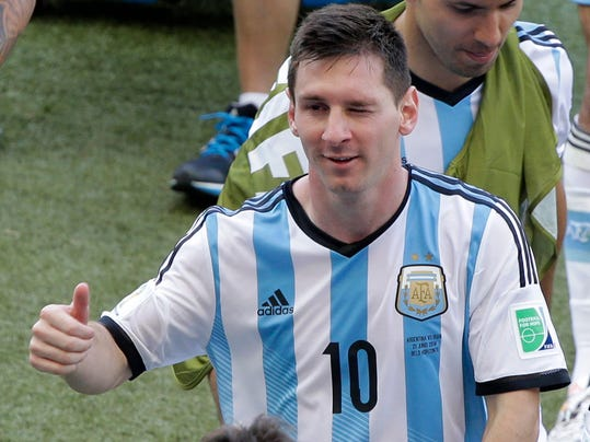 Argentina's Lionel Messi winks as he leaves the pitch after the group F World Cup soccer match between Argentina and Iran at the Mineirao Stadium in Belo Horizonte, Brazil, Saturday, June 21, 2014. Lionel Messi scored a superb goal in stoppage time to give Argentina a 1-0 victory over Iran.(AP Photo/Sergei Grits)