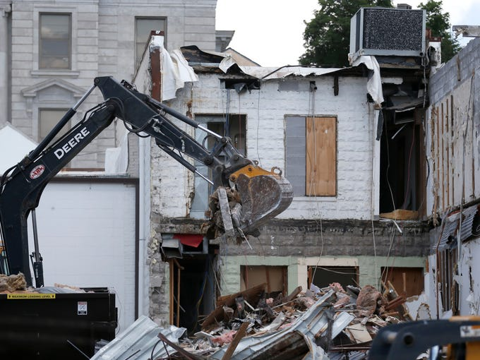 Demolition crews started razing buildings along the