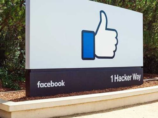 A facebook like thumbs up on a sign.