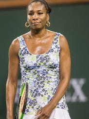 Venus Williams of the United States of America reacts