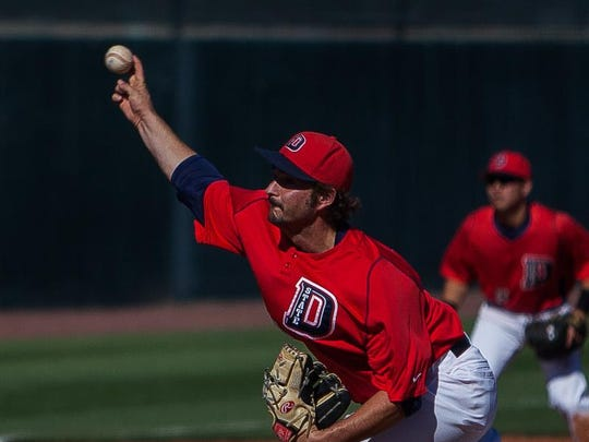 Dixie State's John Conquy pitches against Fresno Pacific at Bruce Hurst Field on Friday.