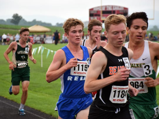 Robert E. Lee's Oliver Wilson-Cook stays with the lead pack in the early stages of the Class 2 boys 3,200-meter run at the VHSL Class 1 & 2 track championships on Saturday, June 2, 2018, at East Rockingham High School in Elkton, Va. Wilson-Cook went on to win the race.