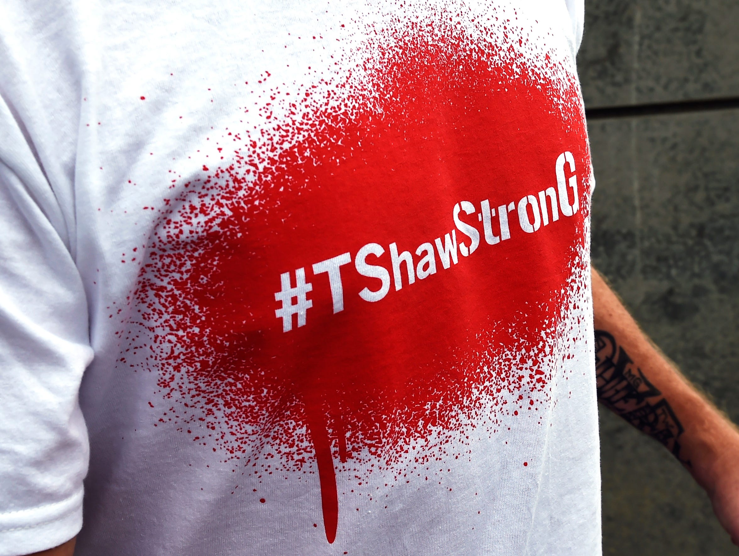 Tim Shaw wears a T-shirt with his hashtag, #TShawStronG.