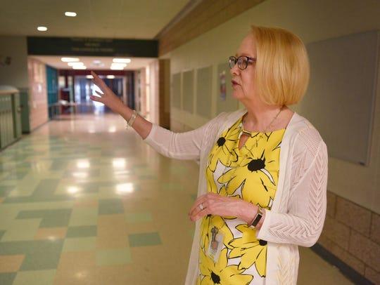 Principal Carrie Aaron walks through Memorial Middle