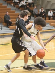 Hartland's Johnathan Jackson dribbles in the lane while