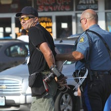 Getty Images photographer Scott Olson is arrested while covering demonstrators in Ferguson, Mo.
