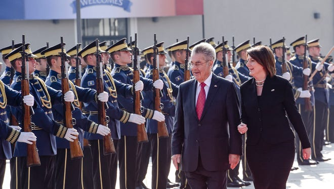 Kosovo President Atifete Jahjaga, right, flanked by Austrian President Heinz Fischer inspecting the honour guard of the Kosovo Security Force, during a welcoming ceremony in Kosovo capital Pristina on Wednesday, Oct. 28, 2015.