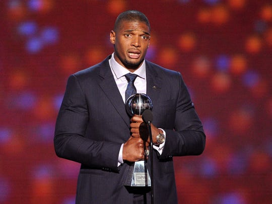 NFL player Michael Sam accepts the Arthur Ashe Courage Award onstage during the 2014 ESPYS at Nokia Theatre L.A. Live on July 16, 2014 in Los Angeles, Calif.