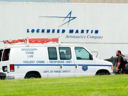 A Mississippi Crime Lab van drives up to the Lockheed-Martin manufacturing plant near Meridian July 8, 2003, where Doug Williams, a Lockheed-Martin employee, is accused of shooting several employees before killing himself.
